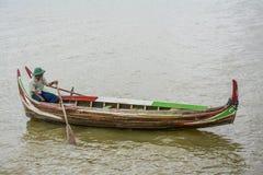 Burmese boatman at U Bein bridge, Taung Tha Man Lake in Amarapura, Mandalay, Myanmar. Stock Images