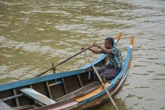 Burmese boatman at U Bein bridge, Taung Tha Man Lake in Amarapura, Mandalay, Myanmar. Royalty Free Stock Images