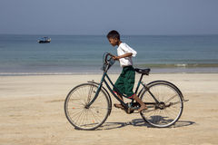 Burmese Boy on a Bicycle - Ngapali Beach - Myanmar Stock Photos