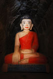 Burmese buddha red robe Stock Photos