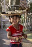 Burmese Child - Mandalay - Myanmar (Burma). A young Burmese girl selling flowers as temple offerings in Mandalay in Myanmar Royalty Free Stock Photo