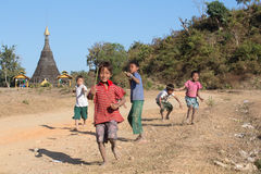 Burmese children are playing near the Buddhist stupa. Mrauk U, Myanmar Stock Photography