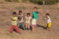 Burmese children are playing near the Buddhist stupa. Mrauk U, Myanmar Stock Image