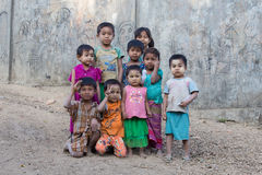 Burmese children are playing near the Buddhist stupa. Mrauk U, Myanmar Royalty Free Stock Photo