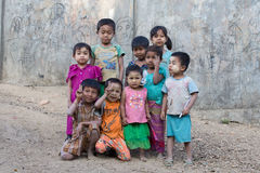 Burmese children are playing near the Buddhist stupa. Mrauk U, Myanmar Stock Photography