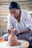 Burmese craftswoman. NYAUNG SHWE, SHAN STATE, MYANMAR - JANUARY 12: Burmese craftswoman poses for a photo at work on January 12, 2012 in Nyaung Shwe, Myanmar stock images