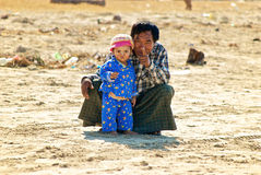 Burmese family. Burmese father and daughter on the beach in the fishing village, near Ngapali Royalty Free Stock Photos