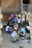 Burmese Family at Home. A Burmese family rests in the shade outside their home in Katha, Myanmar Stock Photography