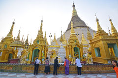 Burmese female devotees from various walks of life praying in Shwedagon Pagoda Royalty Free Stock Photo