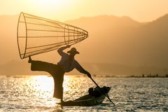 Burmese fisher in Inle lake Stock Images