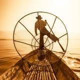 Burmese fisherman on bamboo boat catching fish. Inle lake, Myanmar (Burma) Stock Photography