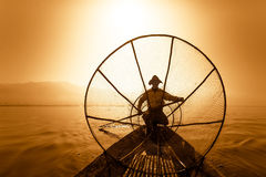 Burmese fisherman catching fish in traditional way. Inle lake, M Royalty Free Stock Photography