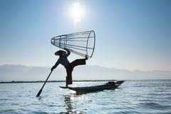 Burmese fisherman catching fish in traditional way. Inle lake, Myanmar Royalty Free Stock Photos