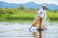 Burmese fisherman at Inle lake. INLE LAKE , MYANMAR - SEP 07 : Burmese fisherman at Inle lake Myanmar on September 07 2017 , inle Lake is a freshwater lake Stock Photo
