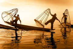 Burmese fishermans on bamboo boats catching fish. Inle lake, Myanmar (Burma) Royalty Free Stock Photography