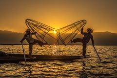 Burmese fishermen on bamboo boats at sunrise Royalty Free Stock Photos