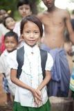 Burmese girl in school uniform, danaka paste. Danaka Paste is used to keep the strong tropical sun away in Burma. In Burma, women, girls, and a lot of the kids stock image