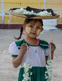 Burmese girl with thanaka on her face stock images