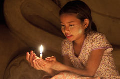 Burmese girl to pay her respect to the Buddha. Stock Image