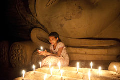 Burmese girl to pay her respect to the Buddha statue Royalty Free Stock Photo