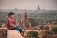 Burmese girls Sitting on a pagoda. Watching the sun at Bagan Mandalay City Myanmar stock image