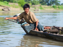Burmese helmsman on the Lemro River Stock Photos