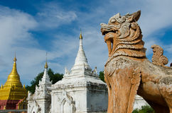 Burmese Lion standing guard over at Inwa Stock Photo