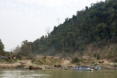 Burmese Logging Camp. A logging camp along the Irrawaddy River in Myanmar stock photo