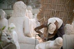 Free Burmese Man Carving A Large Marble Buddha Statue. Stock Photos - 46868873