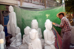 Free Burmese Man Carving A Large Marble Buddha Statue. Royalty Free Stock Images - 46868949