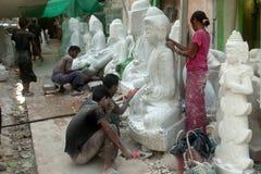 Free Burmese Man Carving And Woman Polishing Large Marble Buddha. Stock Photo - 46868760