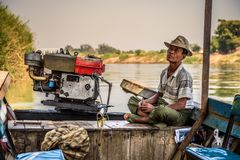 Free Burmese Man Controls A Boat For Travel The Mu River Stock Photography - 103608332