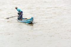 Burmese man handling homemade motor boat in river 2 Royalty Free Stock Photos