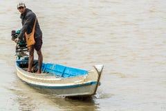 Burmese man handling homemade motor boat in river 1 Stock Image