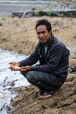 Burmese man holding freshwater fish Royalty Free Stock Photography