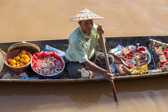 Burmese man on small long wooden boat selling souvenirs, trinkets and bijouterie at the floating market on Inle lake, Myanmar, Bur. INLE LAKE, MYANMAR - JANUARY Stock Photography