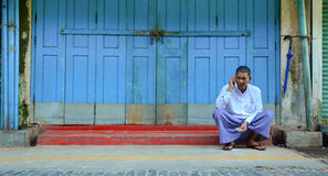 Burmese man talking on mobile phone Stock Image