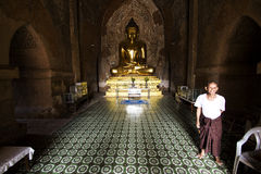 Burmese man in temple royalty free stock photography