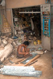 Burmese man working a Brass at Myanmar art work. Royalty Free Stock Photography