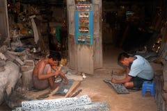 Burmese man working a Brass at Myanmar art work. Stock Image