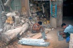 Burmese man working a Brass at Myanmar art work. Stock Photography