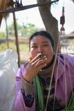 Burmese market woman smoke cheroot cigar Stock Images
