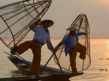 Burmese men catching fish on lake in Inle, Myanmar Royalty Free Stock Photo