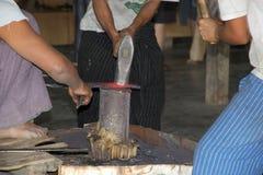 Burmese men are forging a knife Myanmar. Burmese men are forging a knife at the Nan Pan village on the Lake Inle, Shan State, Myanmar stock photography