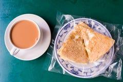 Burmese milk tea and na`an. Burmese milk tea and sweet na`an served on table royalty free stock photography