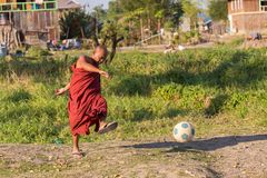 Burmese monk playing football Royalty Free Stock Photos