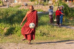 Burmese monk playing football Royalty Free Stock Photo