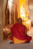 Burmese monk praying in a temple Royalty Free Stock Image