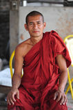 Burmese Monk sitting and facing camera Royalty Free Stock Images