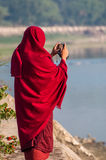 Burmese monk taking a picture. Myanmar Stock Images